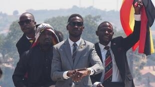 Bobi Wine greets his supporters during a campaign rally on July 11, 2017.