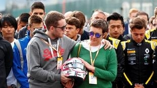 The mother and brother of Anthoine Hubert lead the tributes at the Spa-Francorchamps where he died in a crash.,