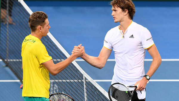 Alex Zverev (right) beat Alex de Minaur on Friday and will take Germany into the last eight of the Davis Cup if he overcomes Nick Kyrgios on Sunday.