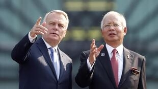 French Prime Minister Jean-Marc Ayrault  with Malaysia's Najib Razak on a visit to the country this week