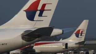 Frota dos aviões da Malaysia Airlines no aeroporto de Kuala Lumpur, 21 de julho de 2014.