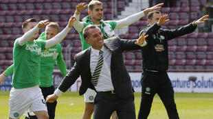 Brendan Rodgers (centre) has led Celtic to the Scottish title in his first season in charge.