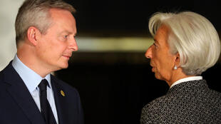 France's Finance Minister Bruno Le Maire and International Monetary Fund (IMF) Managing Director Christine Lagarde talk after posing for the official photo at the G20 Meeting of Finance Ministers in Buenos Aires, Argentina, July 21, 2018.