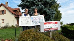 Membros de uma associação de residentes protestam contra a instalação de torres eólicas em Montagne-Fayel, norte da França, 27 de setembro de 2017