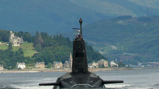 A Trident submarine leaving its base on the Clyde, Scotland