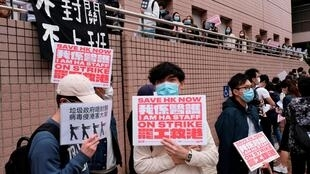 Medical workers hold a strike the outside Hospital Authority as they demand for Hong Kong to close its border with China to reduce the coronavirus spreading, in Hong Kong, China February 4, 2020.