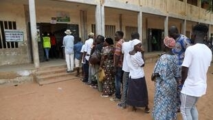 Togo presidential elections: voters queing up at a voting bureau in capital Lomé, 22 February 2020