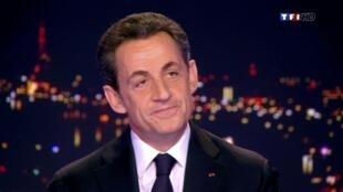 Nicolas Sarkozy ao confirmar que é candidato à reeleição presidencial na França.