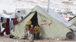 Tous les réfugiés syriens du Liban sont logés à la même enseigne dans les camps en raison des intempéries, ici près d'Arsal, dans la plaine de la Bekaa.