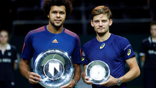 Jo Wilfried Tsonga (left) beat David Goffin for the fourth time in six encounters to claim the Rotterdam Open.