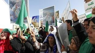 Not angry - pro-Kadhafi supporters demonstrate Thursday