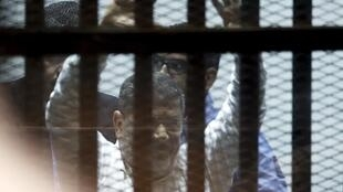 Egypt's ousted president Mohamed Morsi, sentenced to 20 years in prison on Tuesday for violence, kidnapping and torturing protesters in 2012