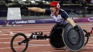 Britain's David Weir celebrates after winning the Men's 1500m T54 Final during the London 2012 Paralympic Games