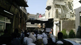 Protests against Syria's President Bashar al-Assad at al-Midan district in Damascus 4 January