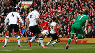Manchester United's Marcus Rashford scores his second goal against Liverpool