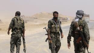 Combatentes curdos no Iraque, em foto de agosto de 2014