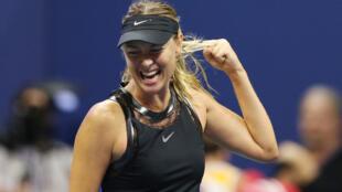 Maria Sharapova ta kasar Rasha, yayinda take murna bayan samun nasara kan Simona Halep ta Romania a gasar kwallon Tennis ta U.S. Open a birnin New York.