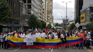 Colombians take to the streets in Bogota to show solidarity with families of victims of the 17 January bomb attack, 20 January 2019