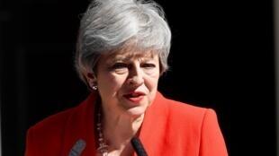 Theresa May devant le 10 Downing Street, à Londres, lors de l'annonce de sa démission, le 24 mai 2019.