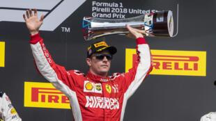 Kimi Raikkonen celebrates winning the United States Grand Prix.
