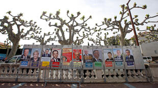 Campaign posters of the 11 candidates who run in the presidential election are seen in Le Soler, near Perpignan, on April 15, 2017.