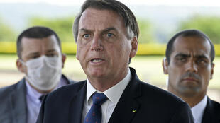 """Brazilian President Jair Bolsonaro, pictured on March 20, has sparked outrage among critics with a national address condemning """"scorched-earth"""" containment measures such as closing businesses and confining people"""