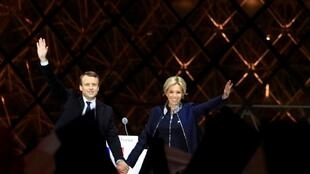 French President elect Emmanuel Macron and his wife Brigitte Trogneux celebrate on the stage at his victory rally near the Louvre in Paris.