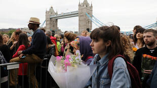 People attend a vigil to remember the victims of the attack on London Bridge and Borough Market, at Potters Field Park, in central London, Britain, June 5, 2017.