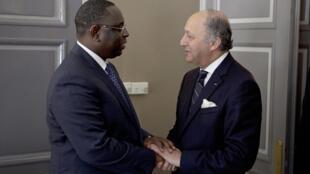Senegal's President Macky Sall welcomes Laurent Fabius to Dakar on Saturday