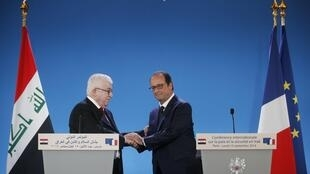 Iraqi President Fuad Masum with France's François Hollande at this week's conference on his country in Paris