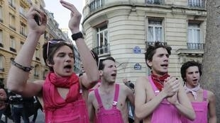 "People wearing pink overalls attend the ""La Manif pour Tous"" (Demonstration for All) protest march against France's legalisation of same-sex marriage, in Paris"