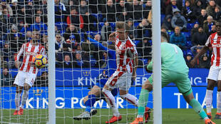 Stoke City's English goalkeeper Jack Butland (2nd R) deflects Albrighton's cross into his own net during the English Premier League football match between Leicester City and Stoke City in Leicester,England on February 24, 201