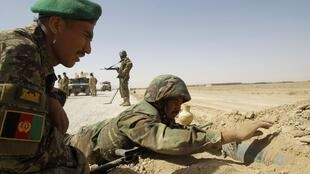 Afghan National Army soldiers take part in an IED detection training course at Camp Hero in Kandahar Province
