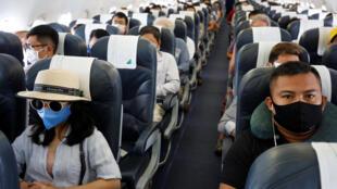 Ảnh minh họa: Hành khách trên một chuyến bay của hãng Bamboo Airways, ngày 07/03/2020