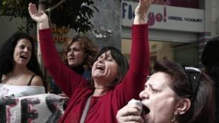Des manifestants contre l'austérité dans les rues d'Athènes, le 5 novembre.