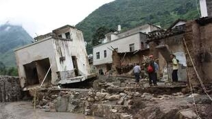 Damaged houses after flash floods hit Xiaohe township of Qiaojia County