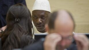 Lubanga speaks to lawyers, ICC courtroom,The Hague, 14 Mar 2012