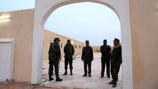 Policemen stand at the entrance of the refugee camp in Tindouf where the three Europeans have been captured, October 2011