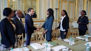 At the Elysées Paris in April 2019, French President Emmanuel Macron greets members of Ibuka, France-based association for rememberance, support and justice for victims of Rwandan genocide