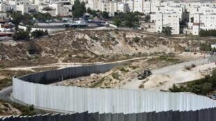 The Pisgat Zeev  seen over the Israeli separation wall at Jerusalem