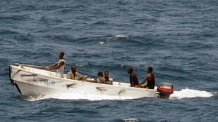 Men believed to be pirates in a boat off the Somali coast