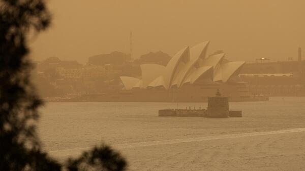 The Sydney Opera House is obscured by smoke haze from bushfires.