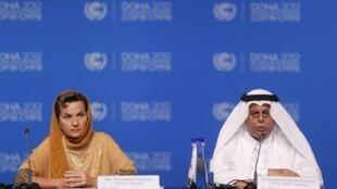 O vice-primeiro-ministro do Catar, Abdullah Al Attiyah, e a costarriquenha Christiana Figueres, chefe do Secretariado de Mudanças Climáticas da ONU.