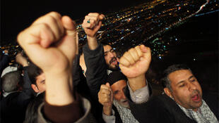 Iranians gather on the roof of Tehran's telecommunication tower to mark the 32nd anniversary of the Islamic revolution.