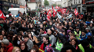 Rail strikers and trade unionists demonstrate in Paris on Monday