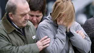 Grieving families of the victims