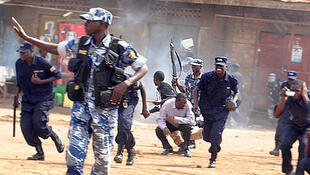 Opposition leader Kizza Besigye takes cover during the attack