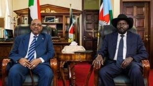 Sudan's President Omar al-Bashir with South Sudan's President Salva Kiir in Juba, 22 October, 2013