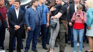 Ukrainian film director Oleg Sentsov, who was jailed on terrorism charges in Russia, hugs his relative upon arrival in Kiev, as Ukrainian President Volodymyr Zelenskiy attends a welcoming ceremony after Russia-Ukraine prisoner swap, at Borispil Internation