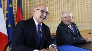 French Finance Minister Michel Sapin with Germany's Wolfgang Schäuble
